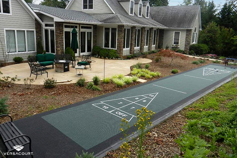 Shuffleboard court installed in a small backyard