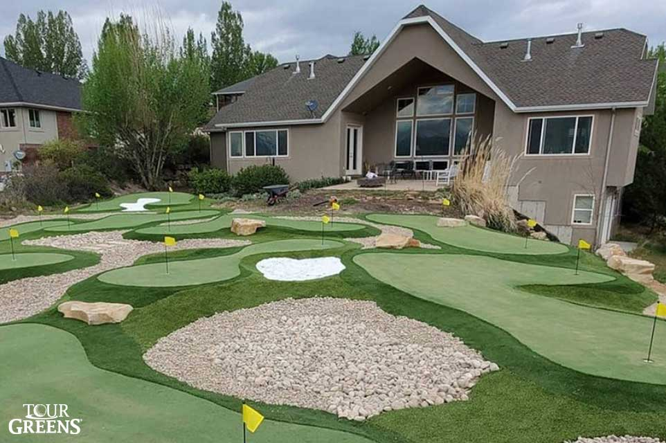 A large backyard converted into a putting green course