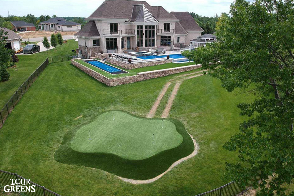 Large backyard with a Tour Greens putting green and shuffleboard court