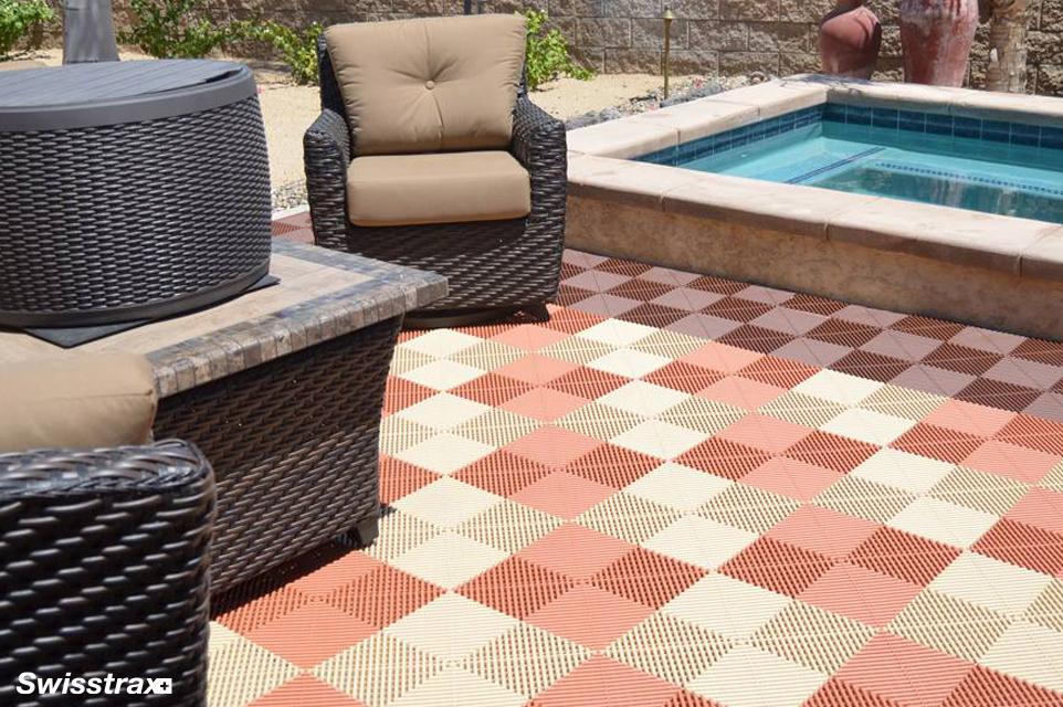 Backyard patio installed with Swisstrax's interlocking floor tiles