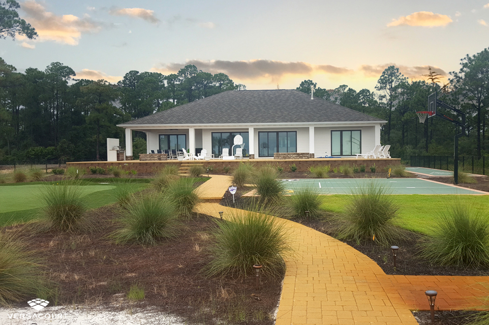 Oceanside home with a tour quality putting green in the backyard
