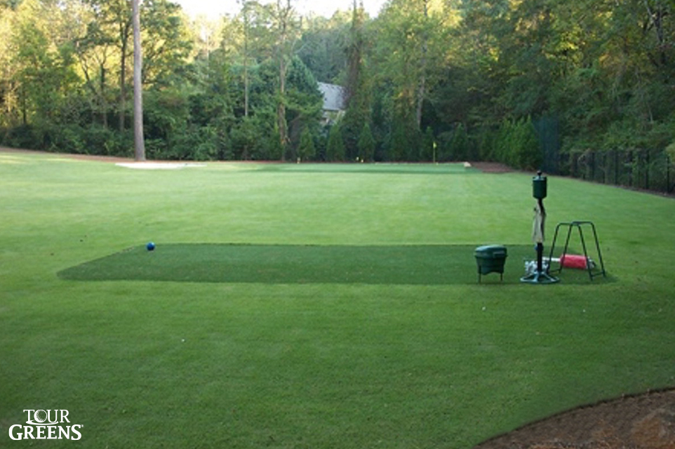 Backyard open space with a Tour Greens hitting mat and short game green installed