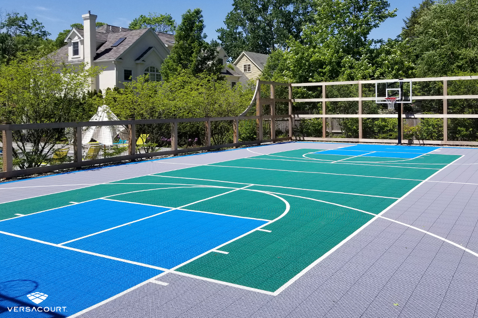 Large backyard designed with a VersaCourt multi-sport game court