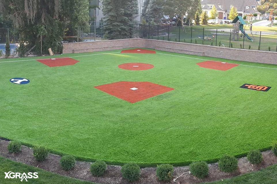 Large backyard baseball field with logos