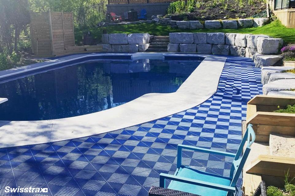 Pool deck with Swisstrax modular flooring tiles installed