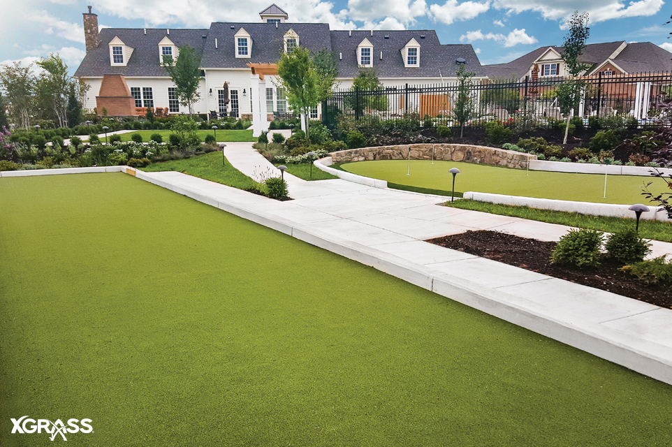 Large backyard with artificial turf bocce court and tour quality putting green installed