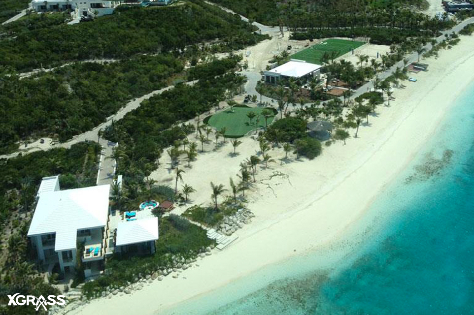 Private beach backyard with a 9 hole golf course and tennis court