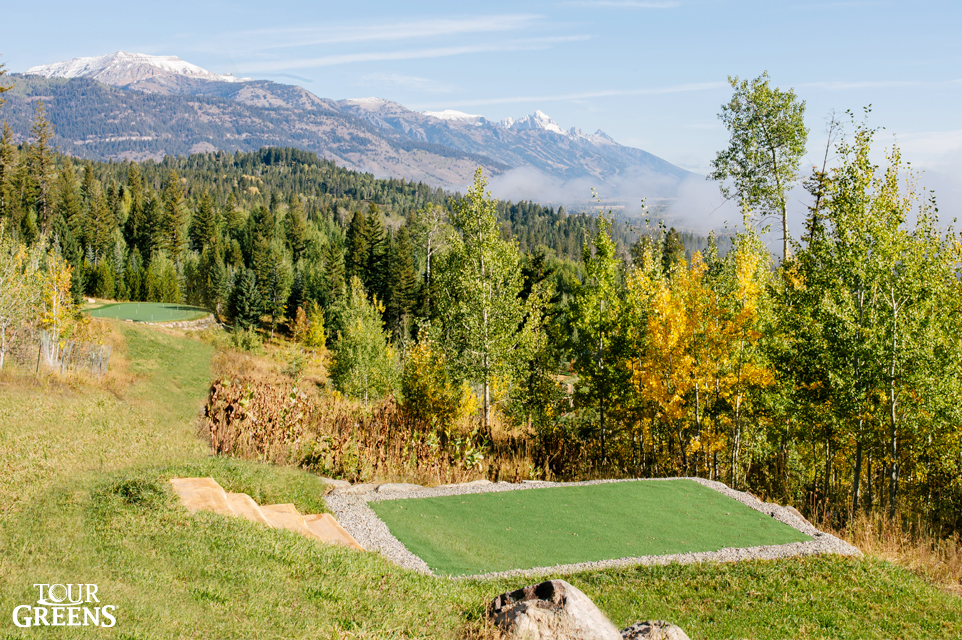 Backyard golf greens installed on the side of a mountain