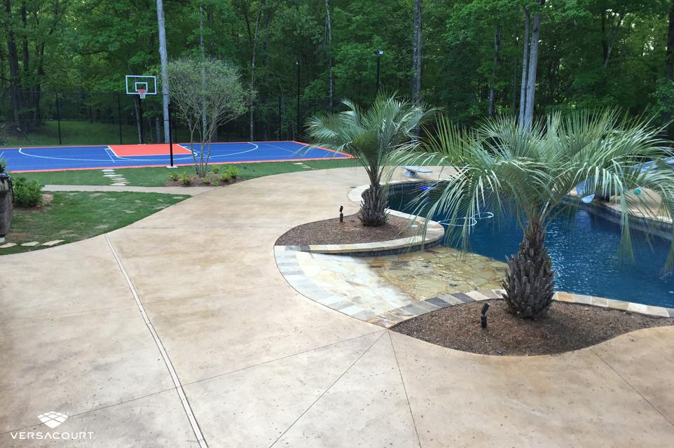 Backyard installed with VersaCourt's multi-sport game court