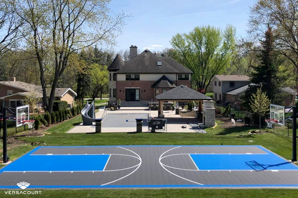Backyard with a full-length basketball court from VersaCourt