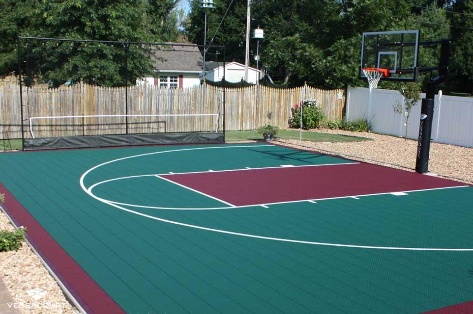 Backyard basketball court with a ball rebounder