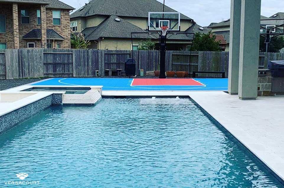 Backyard swimming pool with VersaCourt's multi-sport court