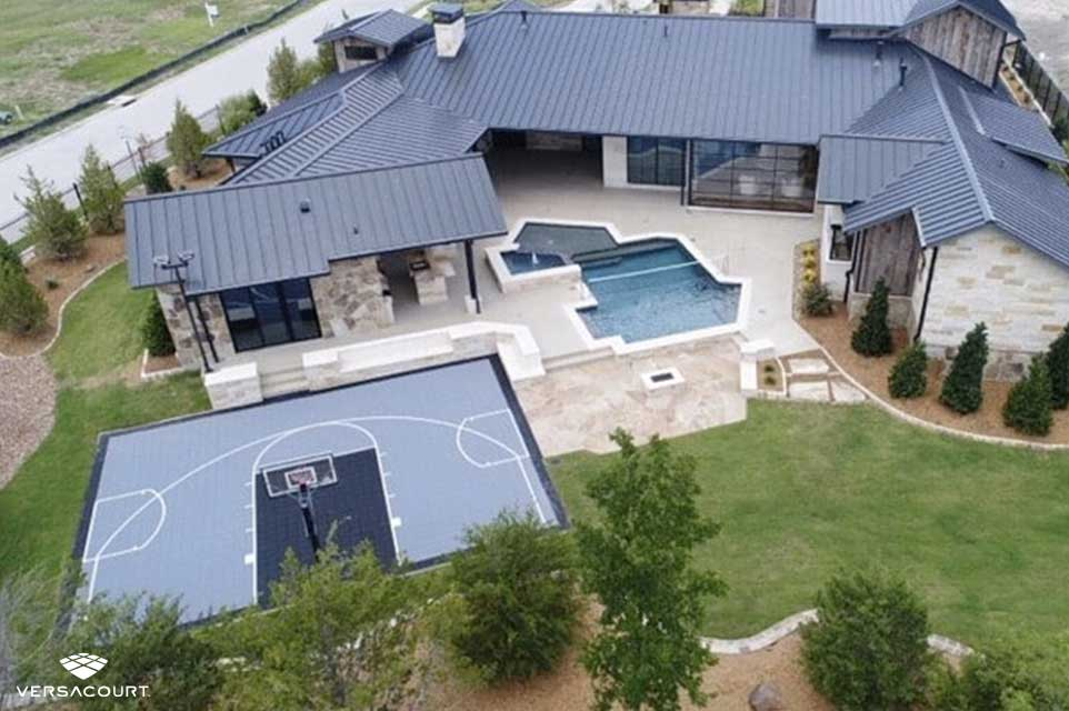 Large home installed with VersaCourt's backyard multi-sport court