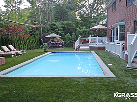 Swimming pool surrounded by artificial turf