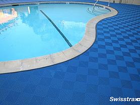 Swisstrax interlocking flooring tiles around swimming pool