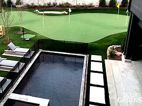 Tour Greens putting green next to swimming pool